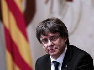 Catalan regional government president Carles Puigdemont attends a regional government meeting at the Generalitat Palace in Barcelona on October 10, 2017.