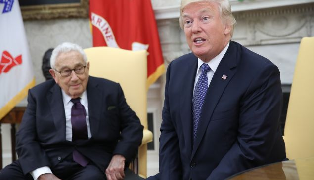 President Donald Trump (R) meets with former U.S. Secretary of State Henry Kissinger (L)