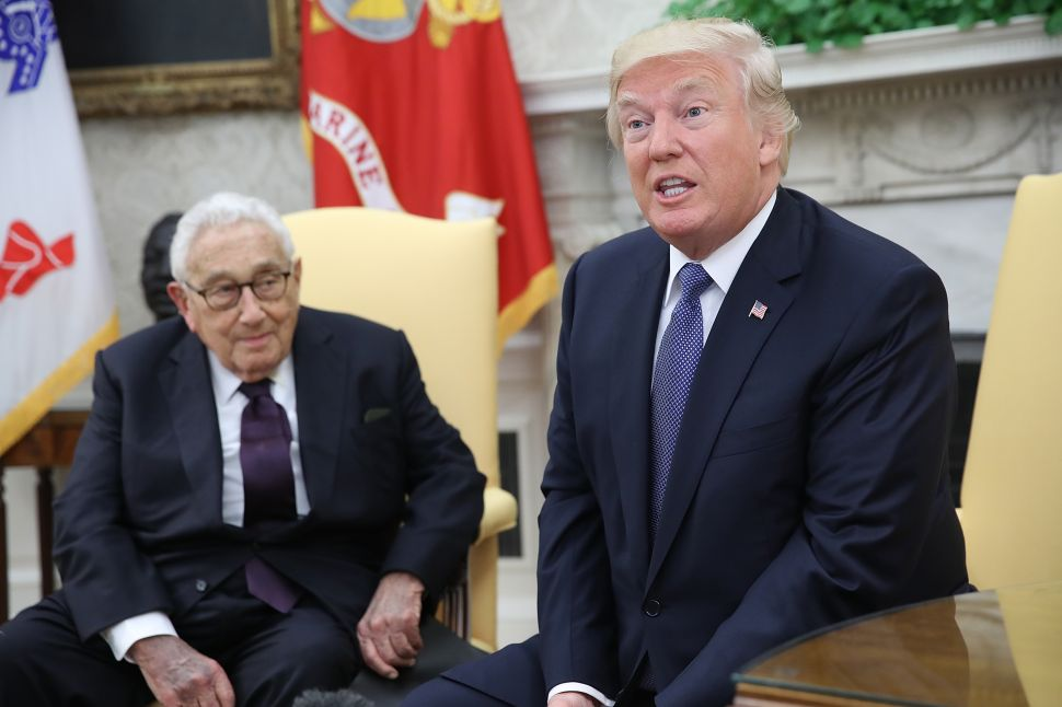 Amid Tillerson Feud, Trump Courts Kissinger