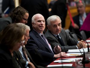 Sen. John McCain (R-AZ) and Sen. Jack Reed (D-RI) attend an Armed Services conference committee meeting on the National Defense Authorization Act on Capitol Hill on October 25, 2017 in Washington, D.C.
