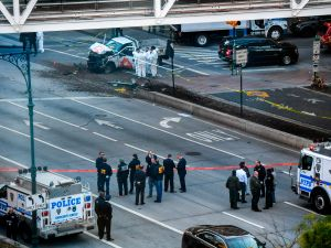 Investigators inspect a rental truck used in a violent attack in New York that left eight dead and 11 injured on Tuesday.