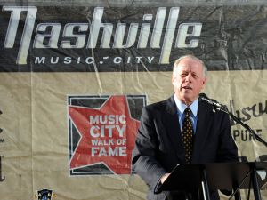 NASHVILLE, TN - NOVEMBER 08: Tennessee Governor Phil Bredesen speaks about Singer & Songwriter Dolly Parton during her induction into the Music City Walk of Fame, At Hall of Fame Park on November 8, 2009 in Nashville, Tennessee. (Photo by )