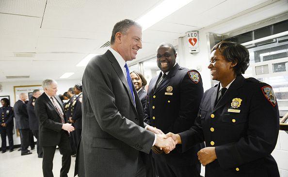 Mayor Bill de Blasio greets correction officers at Rikers Island.