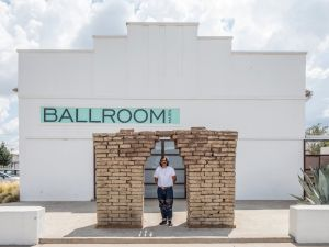 Rafa Esparza outside Ballroom Marfa with his work made in collaboration with Beatriz Cortez, Portal Sur, after Copan, 2017.