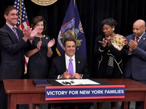Gov. Andrew Cuomo, center, flanked by IDC Leader Jeff Klein and Lieutenant Gov. Kathy Hochul to his left and Senate Democratic Leader Andrea Stewart-Cousins and state Assembly Speaker Carl Heastie to his right.