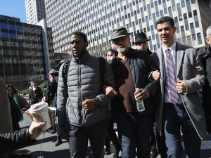 Protesters accompany prominent immigration activist Ravi Ragbir outside the Immigration and Customs Enforcement office at the U.S. Federal building during a solidarity rally against deportation in March. (Photo by John Moore/Getty Images)