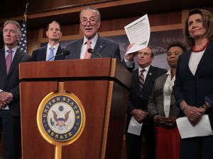 Senate Minority Leader Charles Schumer, center, and other congressional lawmakers discuss the Republican tax and budget plan.