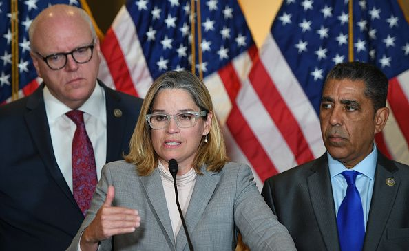 San Juan, Puerto Rico Mayor Carmen Yulín Cruz, center, with Rep. Joseph Crowley (D-Queens/Bronx) to the left and Rep. Adriano Espaillat (D-Upper Manhattan) to the right. ] meeting. / AFP PHOTO / JIM WATSON (Photo credit should read JIM WATSON/AFP/Getty Images)