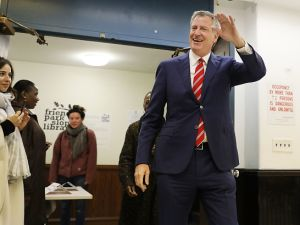 Mayor Bill de Blasio walks into his polling site at the Park Slope Library on Election Day in Brooklyn.