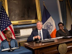 First Lady Chirlane McCray, left, and Mayor Bill de Blasio, right, at a press conference at City Hall.