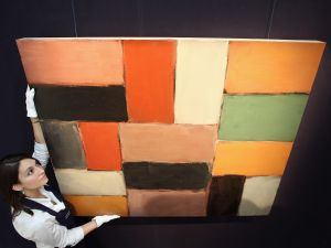 A Sotheby's hangs 'Wall of Light Orange Green' by Sean Scully in preparation for a November 3, 2010 sale.