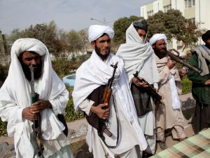 Surrendering Taliban militants stand with their weapons in Herat, Afghanistan.