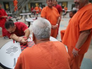 Immigrant detainees talk while in a general population block at the Adelanto Detention Facility on November 15, 2013 in Adelanto, California.
