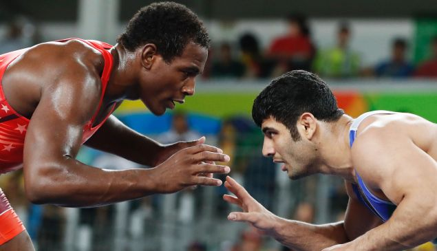 USA's J'den Michael Tbory Cox (red) wrestles with Iran's Alireza Mohammad Karimimachiani during the wrestling event of the Rio 2016 Olympic Games.