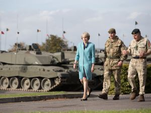 Prime Minister Theresa May walks with Lt Col Paddy Ginn and General Sir Nicholas Carter as she visits 1st Battalion The Mercian Regiment (Cheshire, Worcesters and Foresters, and Staffords) at their barracks at Bulford Camp near Salisbury, England.