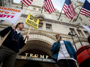 Protestors demonstrate outside the Trump International Hotel.