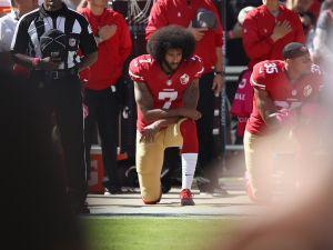 Colin Kaepernick kneels during the National Anthem on October 23, 2016.