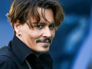Johnny Depp is officially out of the Eastern Columbia Building.