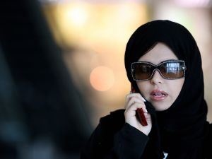 A woman speaks on her phone at a shopping mall in the Saudi capital of Riyadh.