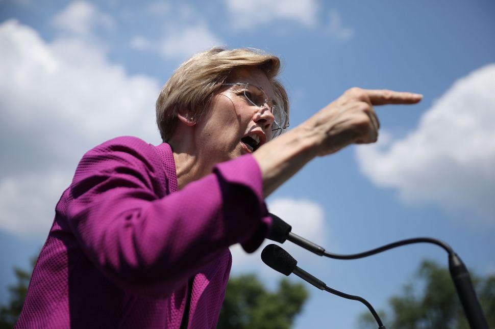 Elizabeth Warren Attacks Neil Gorsuch's Ties to Koch Network
