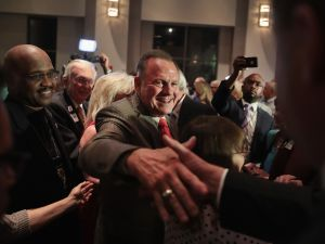 Republican candidate Roy Moore greets
