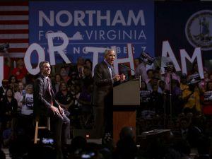 Former U.S. President Barack Obama (R) speaks as he campaigns for Democratic gubernatorial candidate and Virginia Lieutenant Governor Ralph Northam (L).