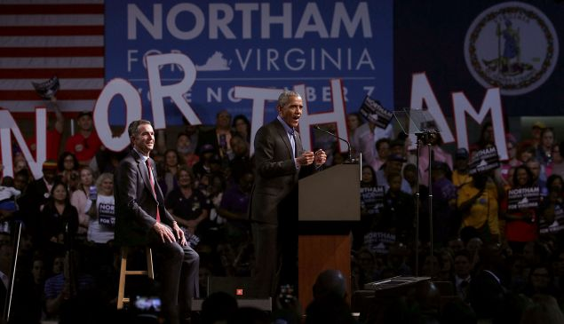 Former U.S. President Barack Obama (R) speaks as he campaigns for Democratic gubernatorial candidate and Virginia Lieutenant Governor Ralph Northam (L).