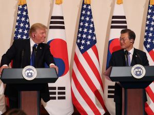 President Donald Trump talks with South Korean President Moon Jae-In during the joint press conference at the presidential Blue House on November 7, 2017 in Seoul, South Korea.