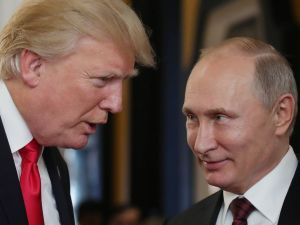 President Donald Trump chats with Russia's President Vladimir Putin as they attend the APEC Economic Leaders' Meeting on November 11, 2017.
