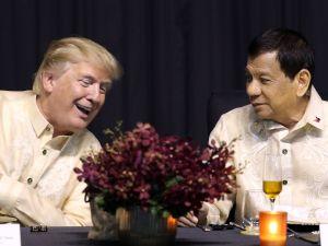 President Donald Trump speaks with Philippines President Rodrigo Duterte in Manila on November 12, 2017.