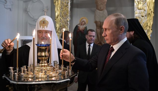 Russian President Vladimir Putin, accompanied by Patriarch of Russia Kirill and Prime Minister Dmitry Medvedev, visits the New Jerusalem Orthodox Monastery outside Moscow on November 15, 2017.