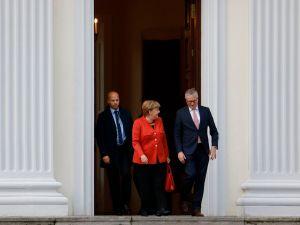German Chancellor Angela Merkel leaves the presidential residence Bellevue Castle in Berlin where she met the German President on November 20, 2017 after coalition talks failed overnight.