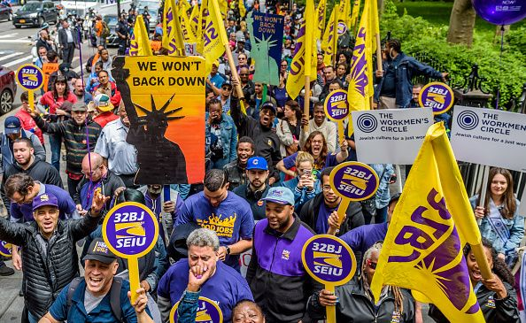 Ahead of an expected Council vote, fast-food workers, cashiers, cooks, delivery people and their supporters rallied outside City Hall.