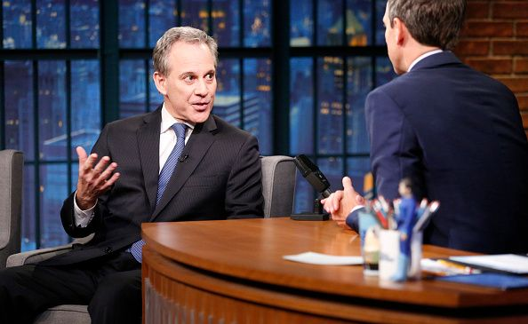 New York Attorney General Eric Schneiderman talks with host Seth Meyers during an interview in July.
