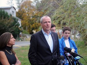 Phil Murphy attends a news conference with wife Tammy Murphy and son Sam after voting on Election Day. (Photo by Bobby Bank/Getty Images)