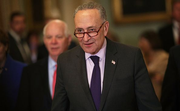 Senate Minority Leader Charles Schumer leaves a press conference.