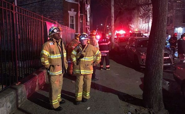 FDNY members operate on scene of a blaze at an apartment building in Bronx.