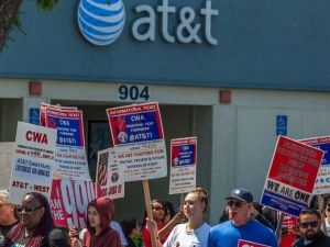 CWA members protesting outside an AT&T store.