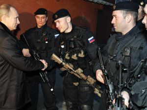 Vladimir Putin shakes hands with local Federal Security Service (FSB) special forces officers during a visit to Chechnya on December 20, 2011.