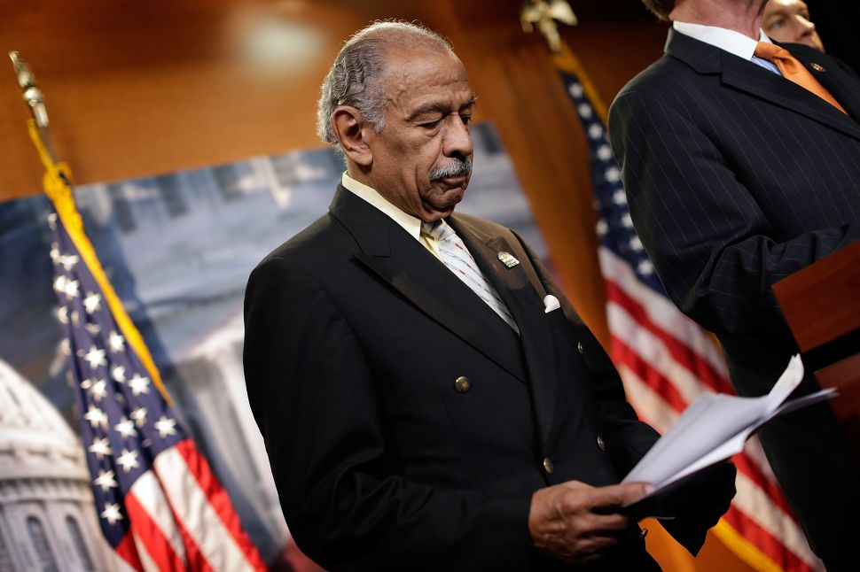 Battered by Sexual Harassment Allegations, John Conyers Resigns From Congress