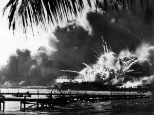 The American destroyer USS Shaw explodes during the Japanese attack on Pearl Harbor, home of the American Pacific Fleet during World War II.