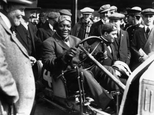 Jack Johnson (1878 - 1946), smiles despite being one of the most unpopular Heavyweight boxers of his time.