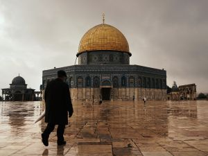 A man walks towards the Dome of the Rock at the Al-Aqsa mosque compound in the Old City in Jerusalem, Israel.