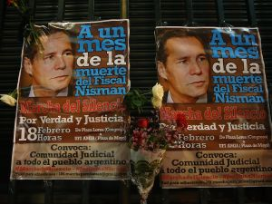 Posters of Albert Nisman are hung during a 'Silent March' marking the one-month anniversary of the suspicious death of special prosecutor Alberto Nisman on February 18, 2015 in Buenos Aires, Argentina.