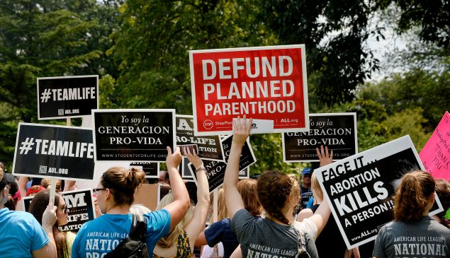 Anti-abortion activists hold a rally opposing federal funding for Planned Parenthood in Washington, D.C.
