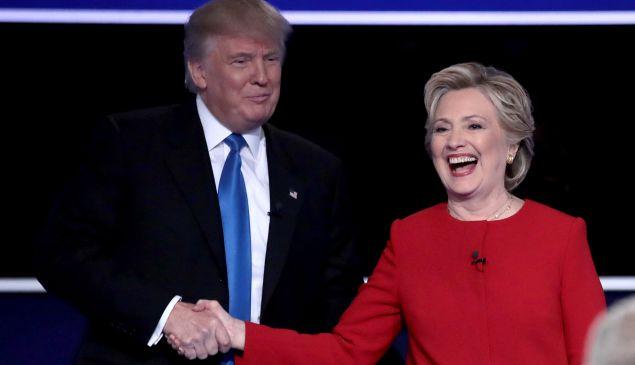 Republican presidential nominee Donald Trump and Democratic presidential nominee Hillary Clinton shake hands after the Presidential Debate at Hofstra University on September 26, 2016 in Hempstead, New York.
