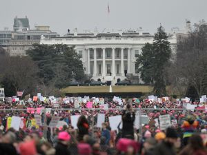 Demonstrators protest near the White House in Washington, DC, for the Women's March on January 21, 2017.