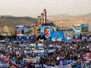 Hundreds of thousands of Yemenis hold posters and portraits of former president Ali Abdullah Saleh during a demonstration in support of the former president on August 24, 2017.