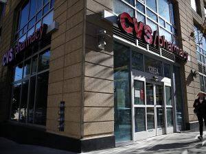 A pedestrian walks by a CVS Pharmacy in San Francisco, California.
