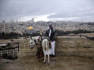 JERUSALEM - DECEMBER 06: A man stands as the Qubbat al-Sakhrah (Dome of the Rock) is seen behind him, at Al Aqsa Mosque Compound in Jerusalem on December 06, 2017. Sacred to Muslims, Jews, and Christians; Jerusalem city is home to the Al-Aqsa Mosque and Dome of the Rock. For Muslims, Al-Aqsa represents the world's third holiest site, after the holy cities of Mecca and Medina in Saudi Arabia. Jerusalem, which has the religious significance for 3 monotheistic religions, hosts people from many different countries. U.S. President Donald Trump is expected to formally recognise Jerusalem as Israel's capital today and begin preparations to move the U.S. embassy from Tel Aviv to Jerusalem. (Photo by )